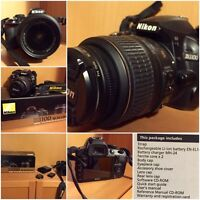 Nikon D3100 with 18-55mm lens and kit