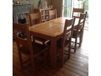 Solid Oak extendable dining table.