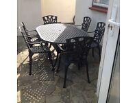CAST ALUMINIUM GARDEN TABLE AND 6 CARVER CHAIRS BLACK