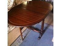 Mahogany drop-flap dining table