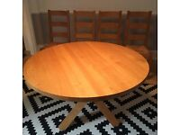 Solid Oak dinning room table and 4 chairs