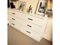 Two sets of white drawers