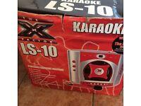 Karaoke LS-10 new with built in Speakers.