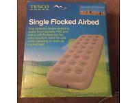 Single flocked air bed