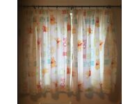 Winnie the Pooh curtains, and two sets of single duvet covers and pillow cases