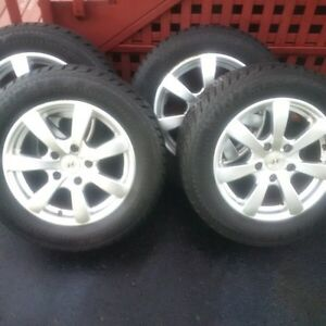 Studded winter tires on rims - 195/65R15