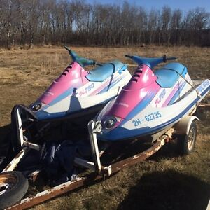 Two 1993 Polaris Sl 750's and double trailer