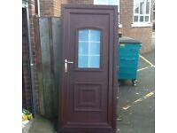 Refurbished upvc rosewood front door