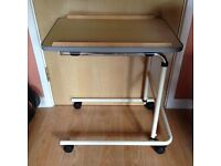 Over bed table - ideal for disabled/ bed bound. Swivel wheels with brakes.