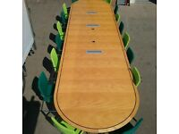 Very large executive boardroom table with chairs