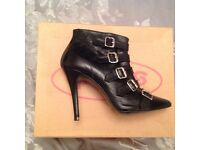 Schuh black multi buckle black leather Ankle boots, size 4