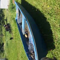 Larger blue paddle boat ready for water need gone.