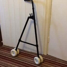 Walking Aid with hand bag hook and swivel wheels adjustable height.