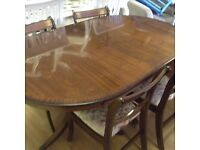 Extending Mahogany table with four chairs