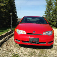 2007 Saturn ION has two small doors Coupe (2 door)
