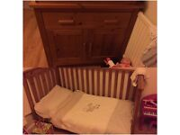 Cot bed and changing unit