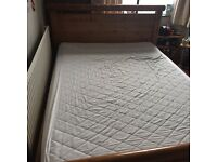 Wooden double bed excluding mattress