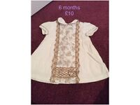 Baby girl dress ranging in sizes from newborn up