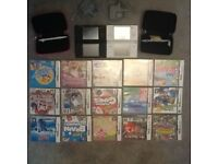 Pair of Nintendo DS game consoles and bundle of games