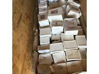 Boxes of white upvc poly top nails and pins
