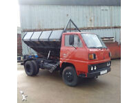 Left hand drive Mitsubishi Canter FE110 2.7 D 6 tyres steel body 3 way tipper.