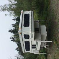 Palomino Bronco 600 slide in, pop up truck camper.