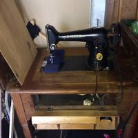 Antique singer sewing machine the folds into own table