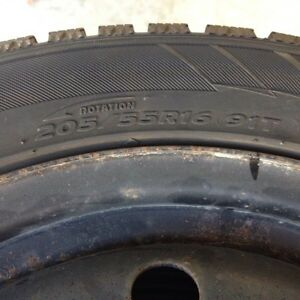 P205 55R16 rated 91T snow tires and 5 bolt rims.
