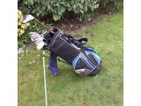Complete golf club set including King Cobra driver, TaylorMade beginner irons and 35 balls