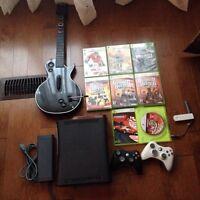 Xbox 360 + manettes sans fil + guitar hero + plusieurs jeux