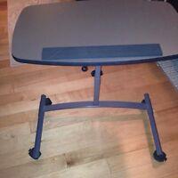 Adjustable laptop tray table on wheels