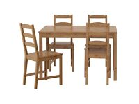 Solid pine dining table and 4x chairs with cushions in perfect condition. RRP: £149