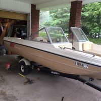 Tri- hull Peterborough boat/ trailer/ motor