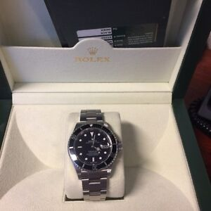Rolex Submariner SS 16610 Box/Paper Mint Condition