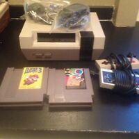 Cleaned and working NES and Super MARIO 3