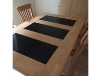 Dining table and 4 beige suede high back chairs