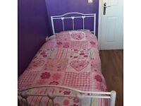 Single white metal bed
