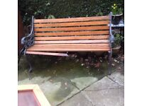 Wrought iron and wood slats garden bench