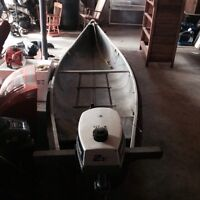 Square back canoe with 2 hp evinrude