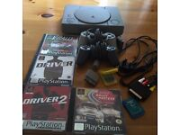 SONY PLAYSTATION 1 WITH 2 OFFICAIL CONTROLS . 2 MEMORY CARDS . ALL LEADS . AND 4 GAMES £35