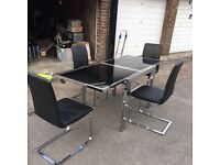 Black glass dining table.