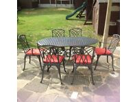 CAST ALUMINIUM GARDEN TABLE AND 6 CARVER CHAIRS