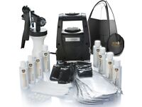 Brand new, never used spray tanning kit with solutions, sticky feet and more!