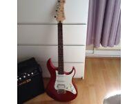 Yamaha electric guitar and amp
