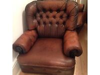 Two brown leather armchairs Chesterfield style £40 each, £60 pair