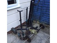 Weights, bar bell s, Bench, spotters and 135 kg of plates. Home gym.