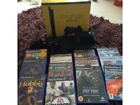 Sony ps2 console boxed with games