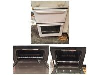 Gas cooker, integrated fridge and glass kitchen wall unit