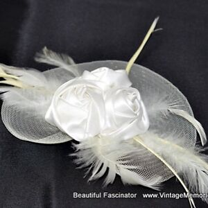 Beautiful feather fascinator and hair clips for wedding on sale