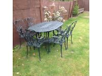 CAST ALUMINIUM GARDEN TABLE AND 6 CARVER CHAIRS GREEN